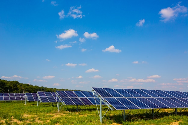 Blue solar panels. power station. solar farm. photovoltaic power systems. solar panel on the sky background.