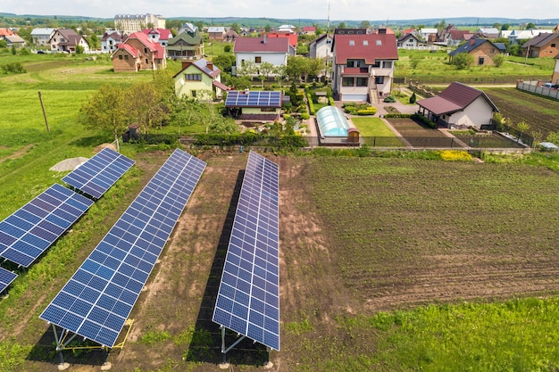 Blue solar photovoltaic panels standing on field