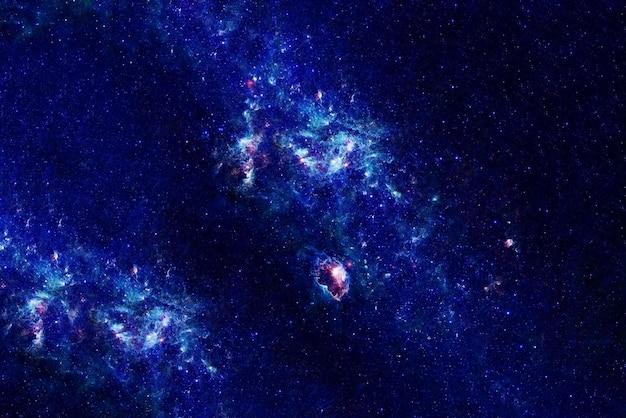 Голубое пространство со звездами. элементы этого изображения были предоставлены наса. фото высокого качества