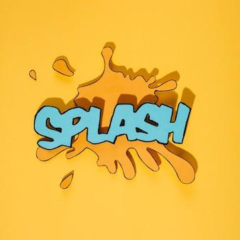 Blue splash text on blot against yellow background