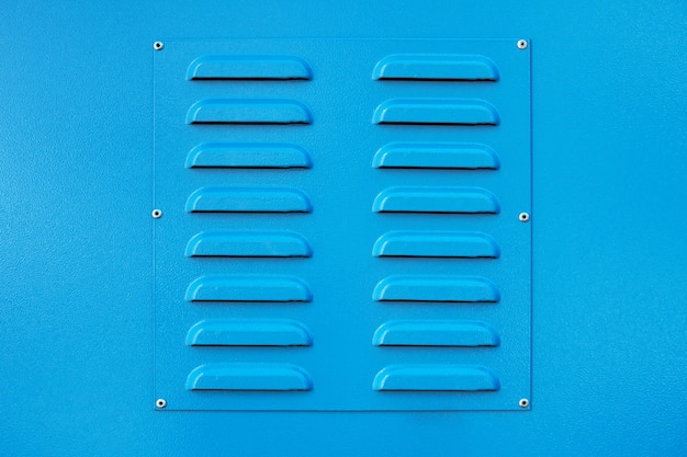 Blue square metal ventilation grate, square shape, new, close view, delivers fresh air and cools