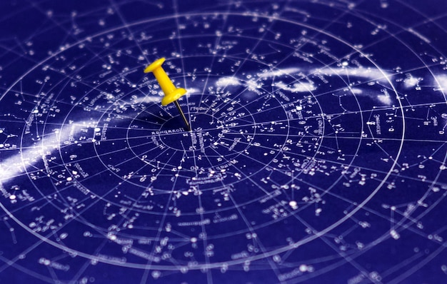 Blue starry sky and pin pointing place on the map