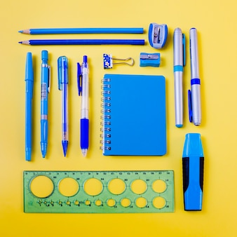 Blue stationery on yellow background