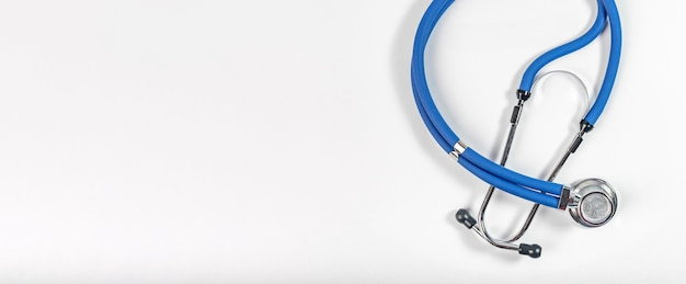 Blue stethoscope on white background, top view. banner with copy space for text