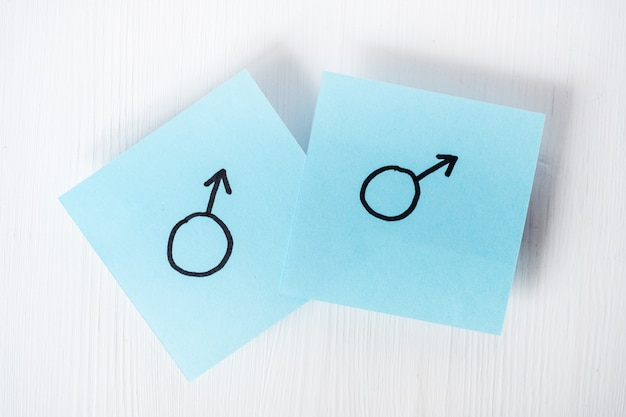 Blue stickers with the gender symbols of mars on white background
