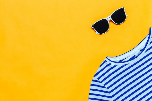 Blue striped t-shirt and white sunglasses on bright