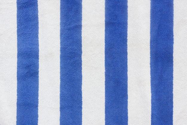 Blue stripped beach towel background extreme closeup.