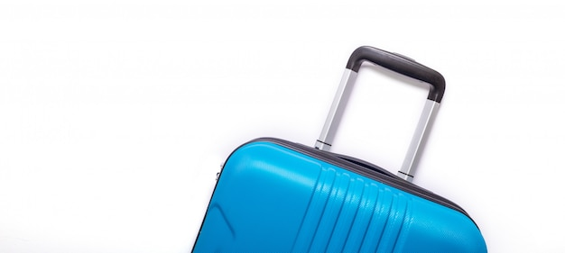 Blue suitcase. creative summer holidays, vacation, travel concept
