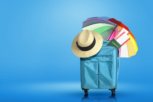 Blue suitcase, hat, ticket, and passport with umbrella with colored background