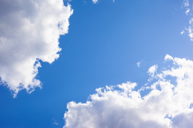 Blue sunny sky with white clouds.