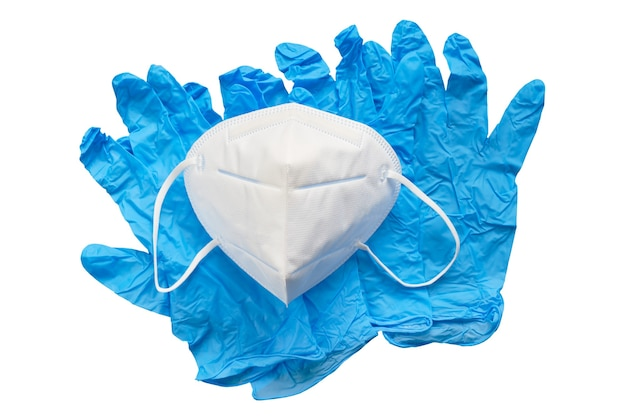 Blue surgical gloves and medical mask isolated on white surface