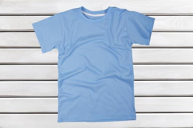 Blue t-shirt isolated on  background