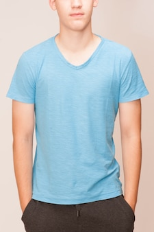 Blue t-shirt on a young man isolated, front