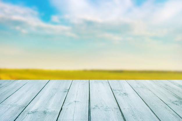 Blue table on blurred background of landscape with blue sky