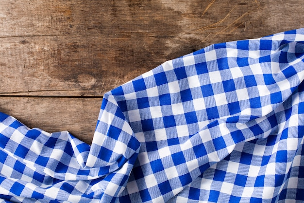 Blue table cloth on wooden background