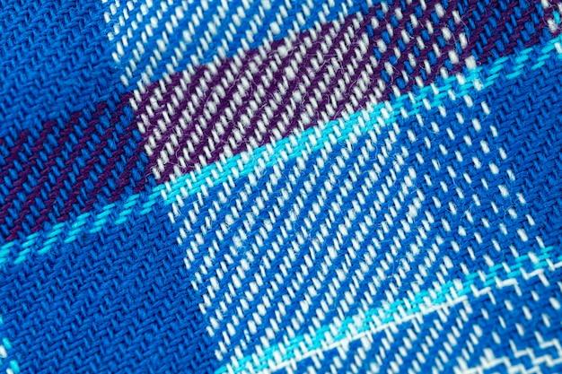 青のタータンパターンと高解像度の生地の質感のクローズアップの背景