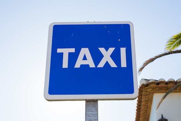 Blue taxi sign in the city centre