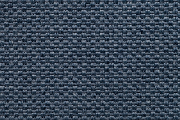 Blue textile background, closeup. structure of the fabric macro.