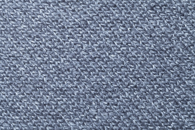 Blue textile background closeup. structure of the fabric macro