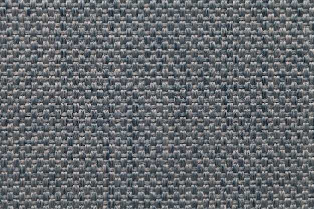 Blue textile background with checkered patterno.