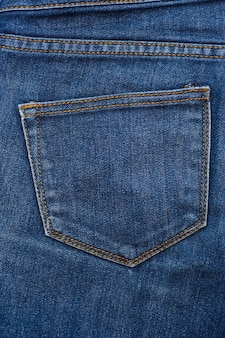 Blue texture of jeans, stitching on the pants closeup