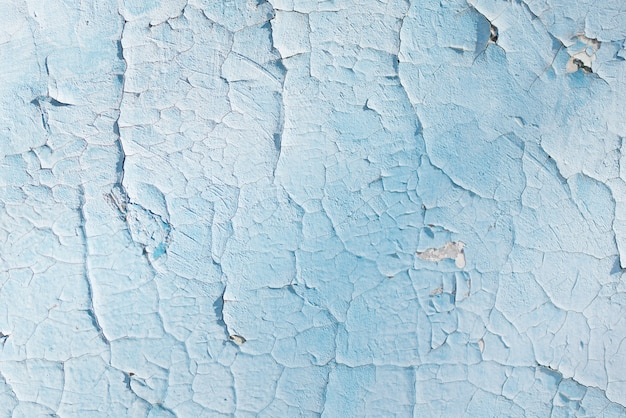 Blue texture with scratches and cracks. blue background. blue and white pattern
