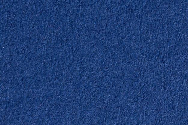 Синий текстурированный фон бумаги. фотография высокого разрешения.