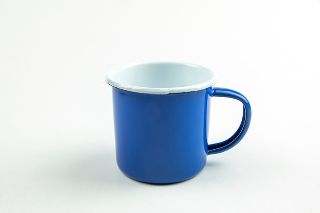 Blue tin cup.