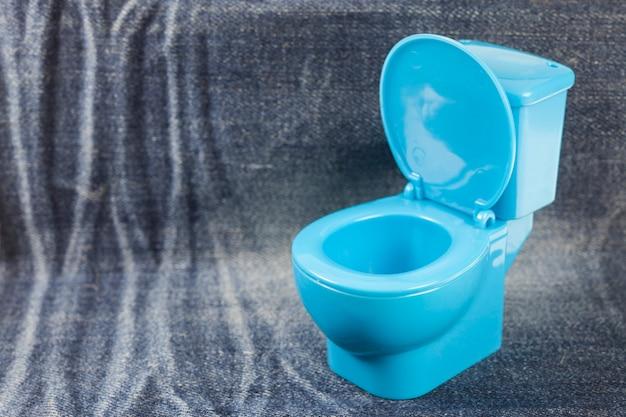 Blue toilet bowl