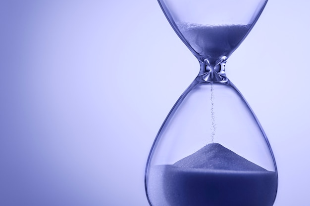 Blue toned hourglass with running sand