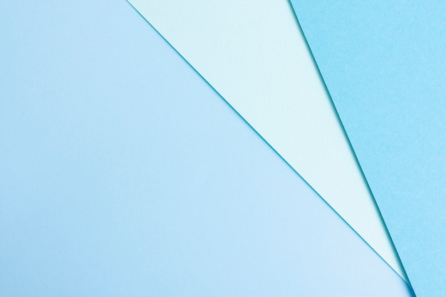 Blue toned set of paper sheets with copy space