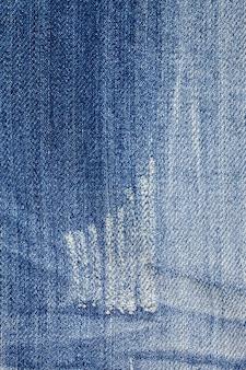Blue torn denim jeans texture