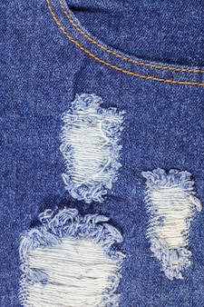 Blue torn denim jeans texture