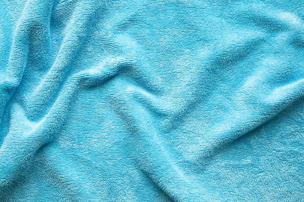 Blue towel fabric texture surface close up background
