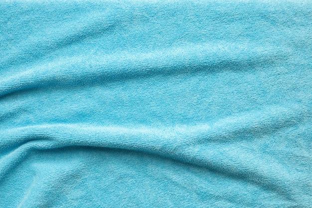 파란색 수건 패브릭 질감 표면 가까이 배경