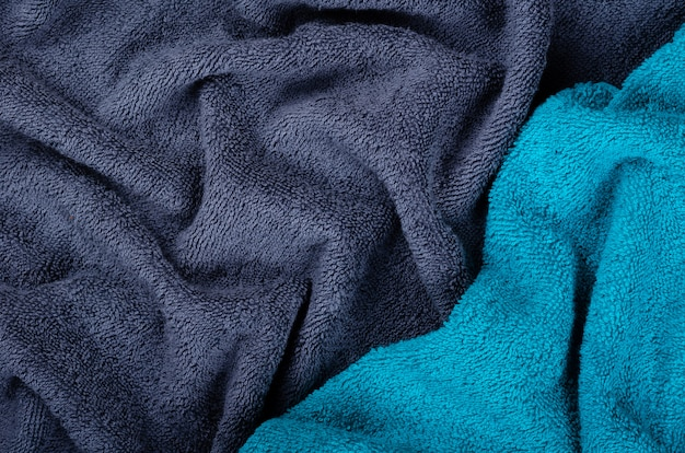 Blue towel fabric texture, top view photo.