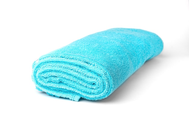 Blue towel isolated on white surface