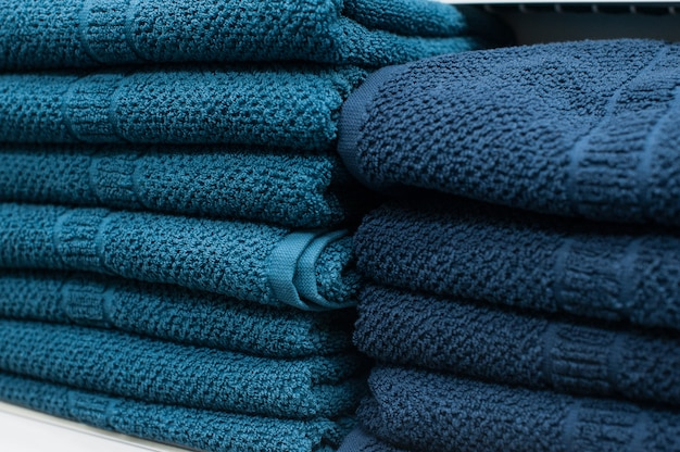 Blue towels on the shelf in the closet
