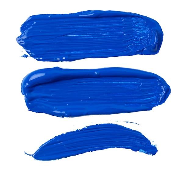 Синие следы краски, изолированные на белом фоне