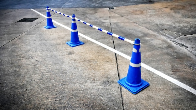 Blue traffic road cones with dashed connecting rods
