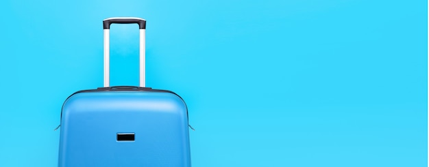 Blue travel suitcase over blue