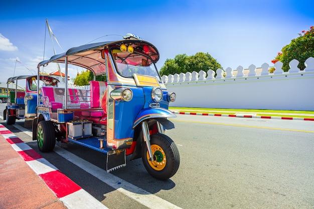 Blue tuk tuk thai traditional taxi in bangkok thailandbangkok traffic in front of giant swing