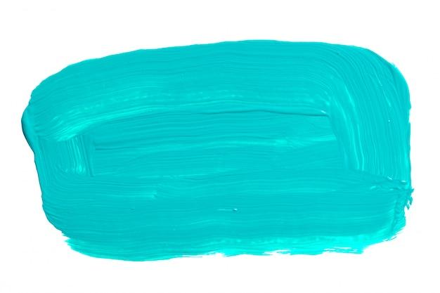 白で隔離される青のターコイズブルーのブラシストローク