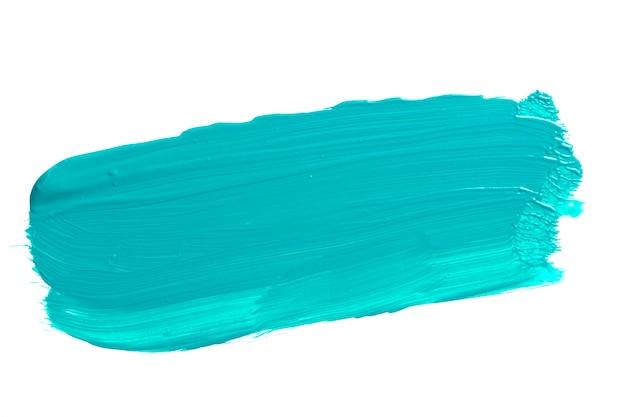 白で隔離される青いターコイズのブラシストローク。