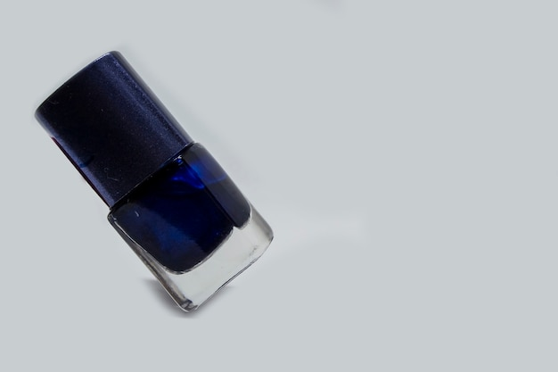 The blue varnish on the white background stands on the edge the balance