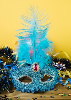 Blue venetian carnival mask with feather and party decoration material