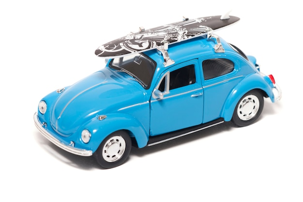 Blue vintage toy car with surf board