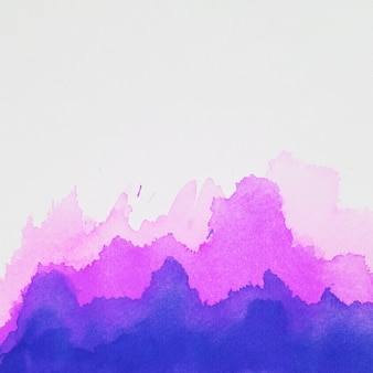 Blue and violet spots of paints on white paper
