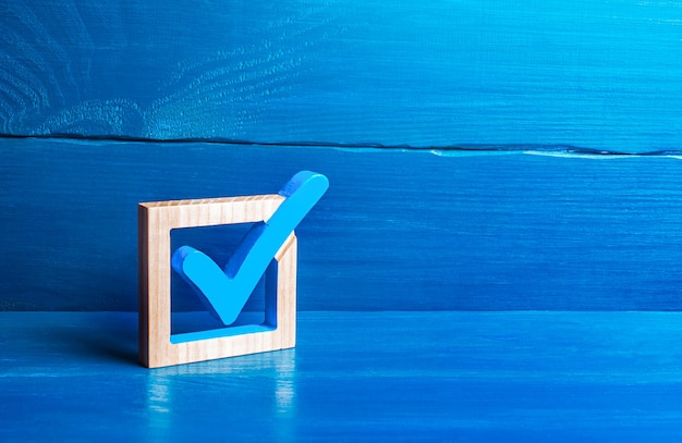 Blue voting tick checkbox choice and guarantee concept democratic elections
