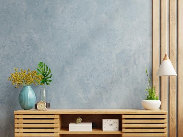 木製キャビネットのモダンな空の部屋の青い壁のモックアップ。3dレンダリング
